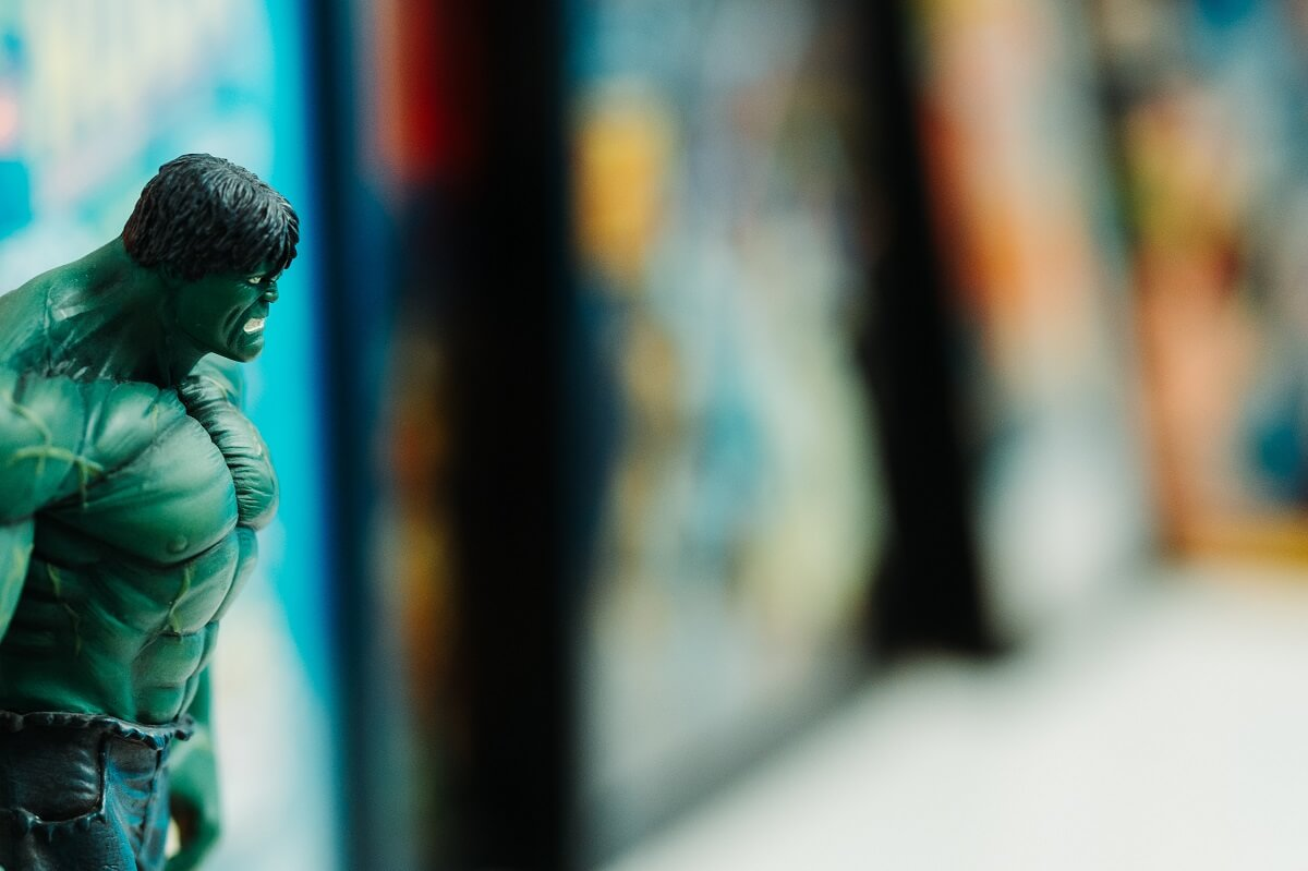 a shallow focus image of a hulk action figure