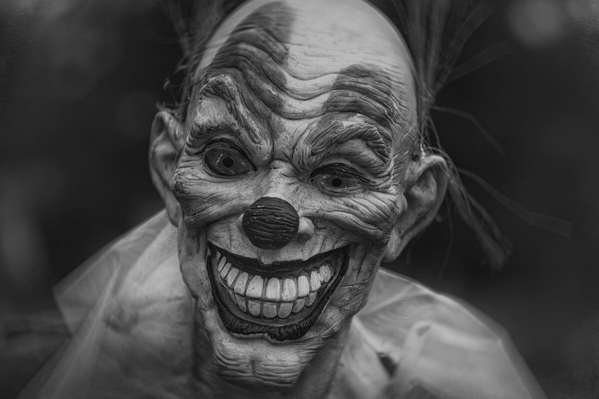 a scary clownface in grayscale