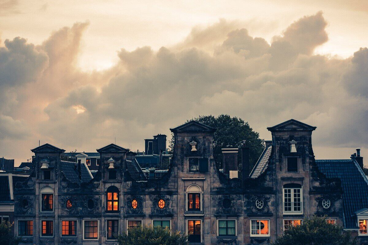 a haunted mansion against a dark sky with orange lights in the windows
